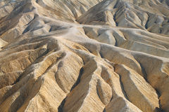 Heavily Eroded Ridges in golden canyon, Death Valley Royalty Free Stock Photo