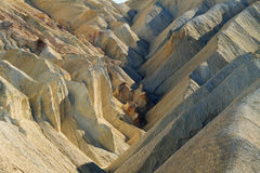 Heavily Eroded Ridges in golden canyon, Death Valley Stock Images