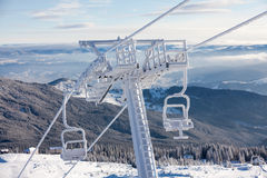 Heavily frozen chairlift at Dragobrat ski resort Royalty Free Stock Photo