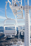 Heavily frozen chairlift at Dragobrat ski resort, Ukraine Stock Photos