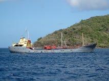 A heavily laden cargo ship at anchor. Stock Photography