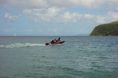 A heavily loaded speedboat in the windward islands Stock Photos