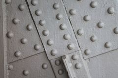 Heavily painted rivet heads background Royalty Free Stock Photography