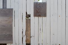 Heavily Repaired Wooden Fence Royalty Free Stock Images