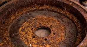 Heavily rusted vintage antique automotive clutch flywheel. Crankshaft bolt holes royalty free stock photo
