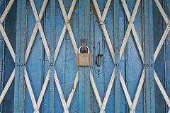 Heavily Secure and Locked Iron Shop Entrance. An entirely locked up business entrance using a lock royalty free stock image