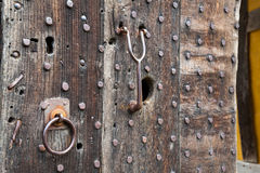 Heavily studded oak door at entrance to castle. Oak studded door at entrance to Stokesay castle in Shropshire Stock Photography