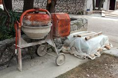 Heavily used electric concrete mixer Stock Photography