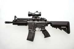 Heavily used military M16 rifle. With short barrel on a white background Stock Images