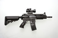 Heavily used military M16 rifle. With short barrel on a white background Royalty Free Stock Photos