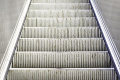 Heavily used and worn escalator stairs Stock Photography