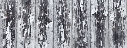 Heavily weathered white gray wooden wall. Detail of a heavily weathered gray wooden wall with remnants of white paint stock photos
