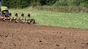 Heavy agricultural machine works in field stock footage