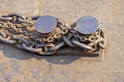 Heavy anchor rusty metal chain in port Stock Images