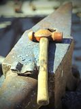 Heavy anvil and hammer in the blacksmith's shop. Heavy anvil and sturdy hammer in the blacksmith's shop Royalty Free Stock Photo
