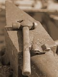 Heavy  anvil and sturdy hammer in the blacksmith's shop. Heavy anvil and sturdy hammer in the blacksmith's shop Stock Photography