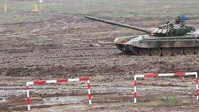 Heavy armor tank in the field. Of battle stock video