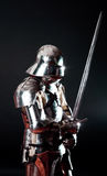 Heavy armoured knight  in combat position Royalty Free Stock Image