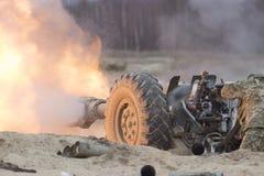 Heavy artillery gun fire on military Stock Photo