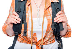 Heavy backpack for traveling on the shoulders of a fragile girl Royalty Free Stock Photo