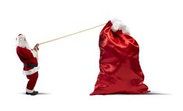 Heavy bag of gifts Royalty Free Stock Photos