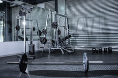 Heavy barbell in empty room Stock Photos