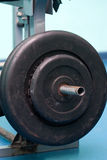 Heavy barbell in holder Stock Photos
