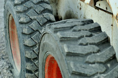 Heavy and big tyres. A construction equipment tyres Royalty Free Stock Photo