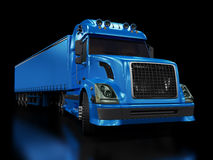 Heavy blue truck isolated on black. Background Royalty Free Stock Image