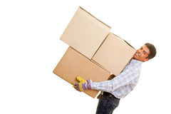 Heavy boxes. Smiling man carrying heavy boxes Stock Photos