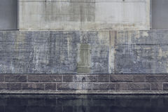 Heavy bridge abutment reflecting in water Royalty Free Stock Photo