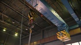 Heavy bridge crane with hook moving alongside the factory stock video