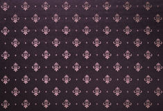 Heavy Brocade Fabric Background. Abstract background of a heavy purple brocade fabric with interwoven repeat design Royalty Free Stock Photos