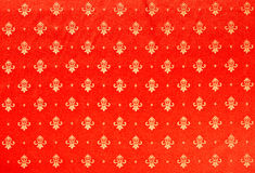 Heavy Brocade Fabric Background. Abstract background of a heavy red brocade fabric with interwoven repeat design Stock Images