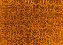 Heavy Brocade Fabric Background. Abstract background of a heavy copper brocade fabric with interwoven repeat design Royalty Free Stock Photography