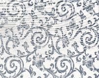 Heavy Brocade Fabric Background. Abstract background of a heavy grey brocade fabric with interwoven repeat design Stock Photography