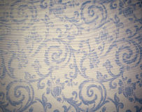 Heavy Brocade Fabric Background. Abstract background of a heavy grey blue brocade fabric with interwoven repeat design Stock Image