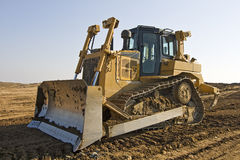 Heavy bulldozer. Bulldozer with a clear blue sky Stock Photos