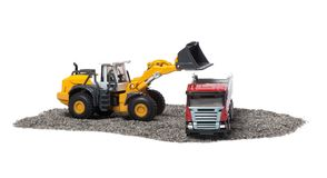 The heavy bulldozer and heavy truck Stock Images