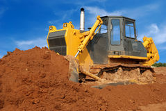 Heavy bulldozer moving sand in sandpit Royalty Free Stock Photography