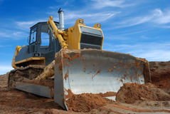 Heavy bulldozer standing in sandpit Royalty Free Stock Photography