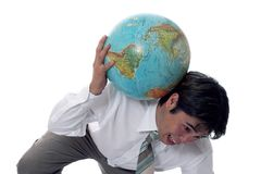Heavy burdon. Asian businessman trying to hold up the weight of the world on his shoulder Stock Images