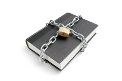 Heavy chain around a book Stock Image