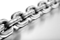 Heavy chain on brushed metal royalty free stock images