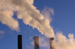 Heavy cloud of smoke from industrial chimneys with copy space stock photography