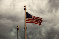 Heavy clouds above US flag Stock Photos