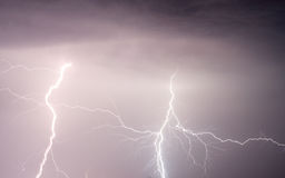 Heavy clouds bringing thunder lightnings and storm Stock Photography