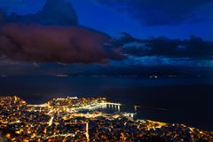 Heavy clouds cape over the city. Heavy clouds cape over city of Kavala, Greece royalty free stock photography
