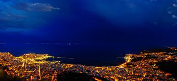 Panoramic view of the city. Heavy clouds cape over city of Kavala, Greece royalty free stock photography