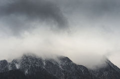 Heavy clouds of dense fog over Bucegi mountains Royalty Free Stock Images